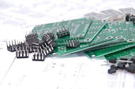 Circuits boards and components with schematic in background